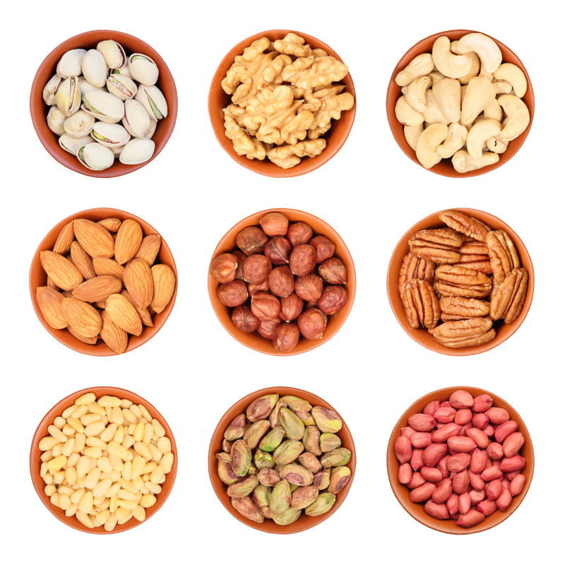 different-types-of-nuts-pistachios-walnuts-cashews-almonds-hazelnuts-pecans-pine-nuts-105758927